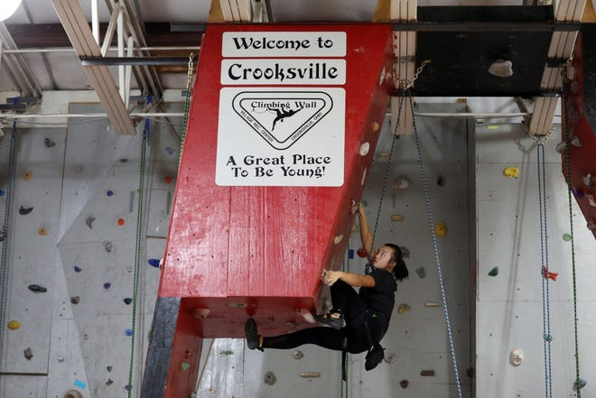 Allison Baughman climbs a route on the Crooksville Recreation Center climbing wall recently. The wall is open Thursday evenings from 6 p.m. to 8.