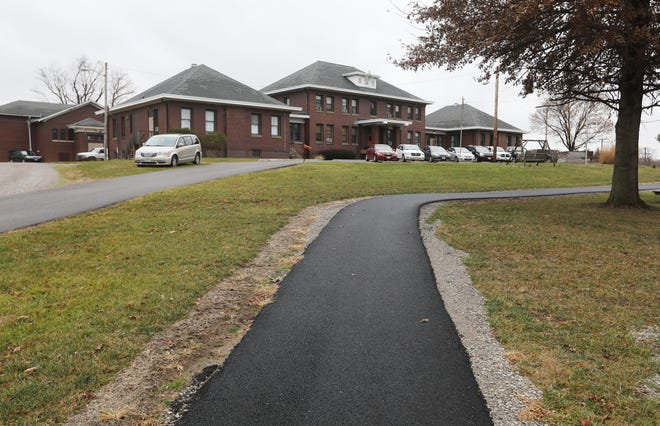 One of the recent improvements to the Avondale Youth Center is the paving of a path around the front of the center's property.