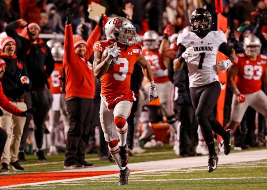 Utah wide receiver Demari Simpkins  runs back a punt return for a touchdown during the third quarter against Colorado at Rice-Eccles Stadium.