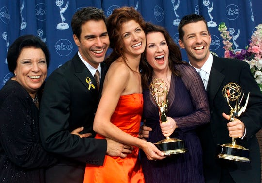 """Shelley Morrison, Eric McCormack, Debra Messing, Megan Mullally and Sean Hayes celebrate at the 52nd annual Primetime Emmy Awards in Los Angeles on  Sept. 10, 2000. Morrison, an actress with a 50-year career who was best known for playing memorable maid Rosario Salazar on """"Will & Grace,"""" has died. She was 83."""