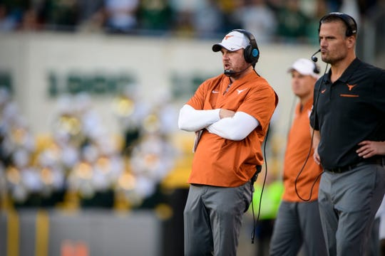 Texas coach Tom Herman, left, and defensive coordinator Todd Orlando stand on the sidelines during their team's game against Baylor at McLane Stadium.