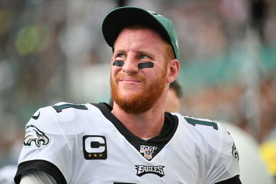 Philadelphia Eagles quarterback Carson Wentz (11) looks on during the second half against the Miami Dolphins at Hard Rock Stadium.