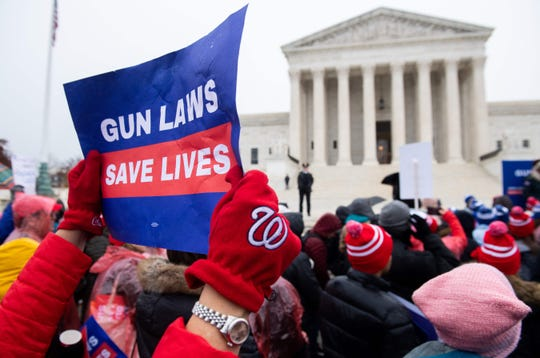 Supporters of gun control and firearm safety measures hold a protest rally outside the Supreme Court as the court hears oral arguments in State Rifle and Pistol v. City of New York, NY, in Washington, D.C., on Monday, December 2, 2019.