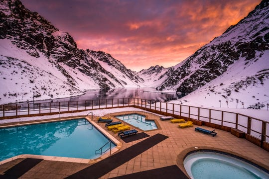 The all-inclusive Portillo ski resort and hotel sits in the Aconcagua Valley of the Andes, the second highest mountain range on earth, with spectacular sunset views over the adjacent alpine lake.