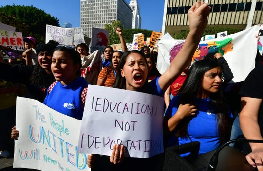 "PLEASE TRANSLATE Students and supporters of Deferred Action for Childhood Arrivals rally in downtown Los Angeles, California on Nov. 12, 2019, as the US Supreme Court hears arguments to make a decision regarding the future of ""Dreamers,"" an estimated 700,000 people brought to the country illegally as children but allowed to stay and work under a program created by former president Barack Obama. The program came under attack from President Donald Trump who wants it terminated, and expired last year after Congress failed to come up with a replacement."