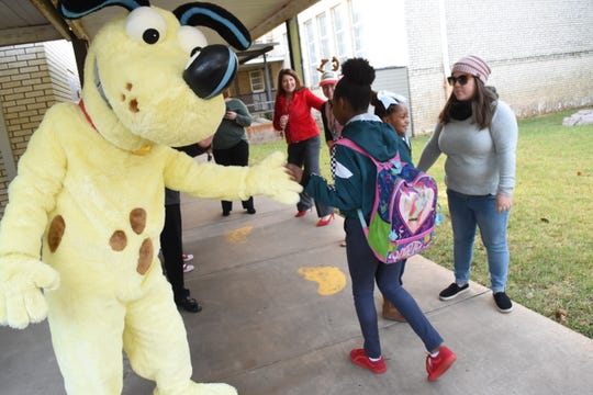 """Hotspot, the Cleco mascot, greets students arriving for school at L.S. Rugg Elementary School last year. """"Each year, we use this time period to raise awareness, educate and assist our customers in keeping their homes and businesses safe and free from electrical hazards,"""" said John Melancon, Cleco's director of corporate safety. """"With more families at home due to the COVID-19 pandemic, paying attention to these hazards is even more important. By taking simple precautions, we can avoid dangerous situations and stay safe."""""""