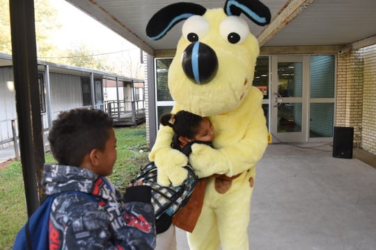 "Employees from Cleco along with their mascot, Hot Spot, greeted L.S. Rugg Elementary School students with music, high-fives and hugs last December for ""Together Tuesdays."" Cleco is encouraging eligible customers who need help paying their electric utility bills to apply for supplemental funds added to the Low Income Home Energy Assistance Program (LIHEAP) as part of the Coronavirus Aid, Relief and Economic Security (CARES) Act."