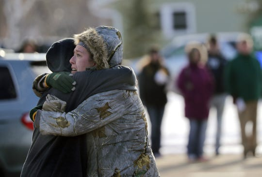Sarah Rogstad, right, hugs Morgan Rogstad, grade 9, after being reunited at the Tipler Middle school reunification center on Tuesday Dec. 3, 2019, in Oshkosh, Wis. Earlier, police responded to an officer involved shooting at Oshkosh West High School after an armed student confronted a school resource officer.