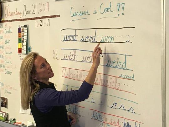 Melanie Derry leads a third-grade cursive lesson at Evergreen Community Charter School.