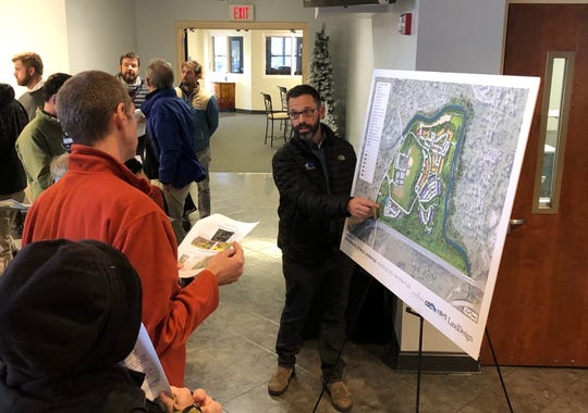 Engineer Chris Day discusses the Crossroads at West Asheville site plan with nearby residents at a community meeting on Dec. 2.