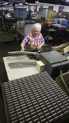 Barbara Machello of South Barre hand-welds capacitors at the SB Electronics plant in Barre in 2004.