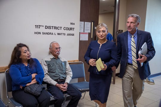 Former Corpus Christi officer Norma Deleon, center, was sentenced by 117th District Court Judge Sandra Watts on Tuesday, Dec. 3, 2019, after being found guilty by a jury on two counts of official oppression on Nov. 18. Exiting the courtroom with defense attorney Terry Shamsie, she is set to return to court in January to serve the jail portion of her sentence, or announce intentions to appeal the misdemeanor convictions.
