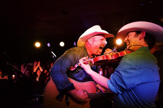Garth Brooks (left) performs his Dive Bar Tour at Prospectors in Mount Laurel on Monday night.