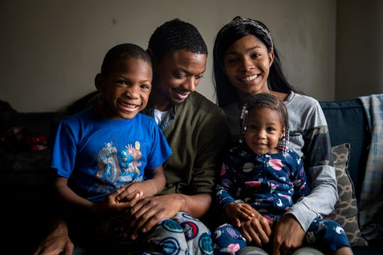Marine Corps veteran LeRon Davis and Erica Owens hold their children Trischan Woodard, 5, and Ahnalia Davis, 2,  in their apartment in Mt. Airy on Thursday, November 21, 2019.