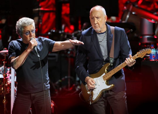 In this Wednesday, Sept. 18, 2019 photo, Roger Daltrey and Pete Townshend with The Who performs during the Moving On! Tour at State Farm Arena in Atlanta.