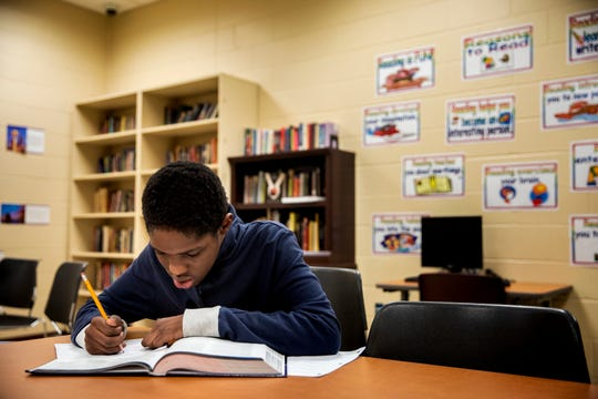 Sha'Rondell Horne, 15, works on his American History vocabulary at The Children's Home of Cincinnati in Madisonville on Tuesday, December 3, 2019.