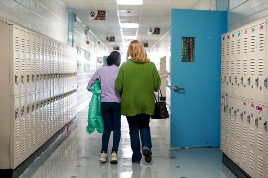 Nevaeh Tolbert, 9, left, and Susan Dickinson, right, walk down the hallways to the cafeteria at Burt Elementary School in Clarksville, Tenn., on Thursday, Nov. 14, 2019.