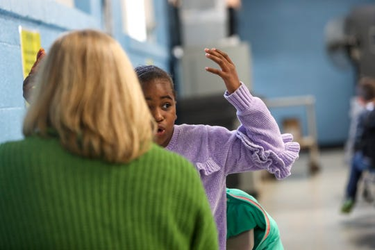 Nevaeh Tolbert, 9, exclaims during conversation with Susan Dickinson during lunch at Burt Elementary School in Clarksville, Tenn., on Thursday, Nov. 14, 2019.