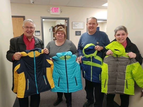 On Nov. 22,Bishop Edward T. Hughes Knights of Columbus Council 15540 donated 48 new winter coats to Readington Township Housing and Social Services in support of Coats for Kids.Pictured from left to right at the Readington Township Municipal building are Financial Secretary Frank Renda and members Christine Deyand Tom andPatricia Monroe.