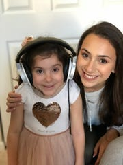 "Bridgewater first-grader Isabel Rita, left, lent her voice to a locally produced charity holiday album, ""Duets from the Heart,"" developed by 17-year-old Calista Quinn. Izzy contributed ""Santa Claus is Coming to Town"" to the fundraiser for Children's Specialized Hospital, where Izzy has been a patient during a five-year battle with a spinal cord tumor."