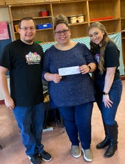 For Giving Tuesday, Mozarts and Einsteins Preschool and Music Academy in Jamesburg gave back. The school donated a check for $1,000 to the music program of Joseph F. Cappello School, a school in Hamilton for children with special needs. Mozarts and Einsteins owner-director Eric Marozine, pictured far left, got his start working at Joseph F. Cappello School. He is pictured with the school's music teacher, Alyssia Auerbach, center, and Mozarts and Einsteins Assistant Director Danielle Ahearn.