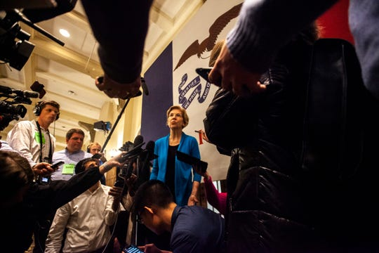 U.S. Sen. Elizabeth Warren, D-Mass., talks with reporters after speaking during a town hall, Monday, Dec. 2, 2019, at the Iowa Memorial Union on the University of Iowa campus in Iowa City, Iowa.