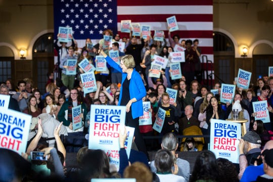 U.S. Sen. Elizabeth Warren, D-Mass., waves to supporters after speaking during a town hall, Monday, Dec. 2, 2019, at the Iowa Memorial Union on the University of Iowa campus in Iowa City, Iowa.