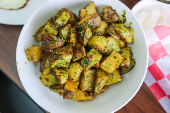 Batata harra — Lebanese-style spicy potatoes with cilantro — from Al Tayeb in Garden City.