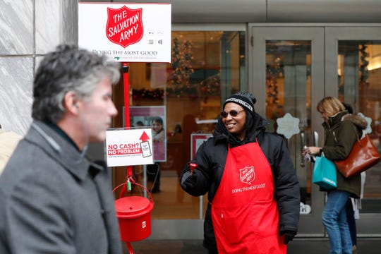 December is a season of giving -- and it might or might not mean a tax break. First see how your itemized deductions add up and whether they would exceed the new higher standard deductions. In this Friday, Nov. 15, 2019, photo, bell ringer Carolyn Harper encourages people to donate to the Salvation Army's annual holiday red kettle campaign on Chicago's Magnificent Mile. Cashless shoppers can give to the Army's red kettle campaign this year using their smartphone.