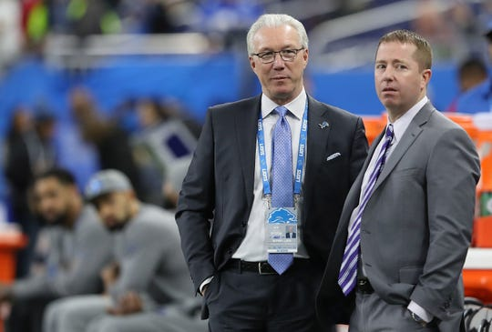 Lions president Rod Wood, left, and general manager Bob Quinn watch warmups prior to the game against the Packers on Dec. 31, 2017 at Ford Field.