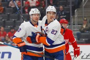 New York Islanders center Anders Lee (27) celebrates his goal with Josh Bailey (12) in the first period Monday.