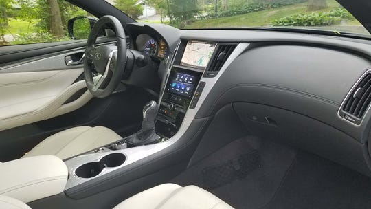 The interior of the Infiniti Q60 Red Sport 400 offers a dual-screen approach to separate media functions from climate and other controls. The design is functional if not as aesthetically appealing as competitor's tablet displays.