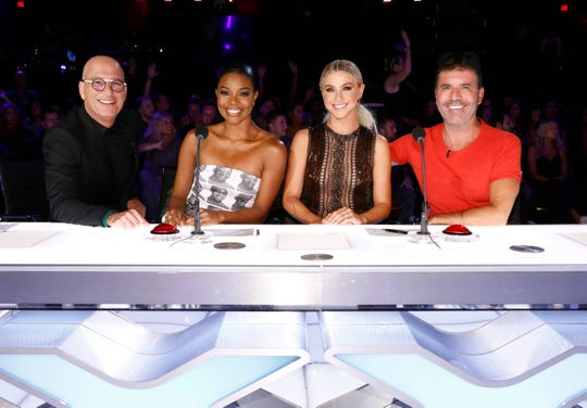 """Celebrity judges, from left, Howie Mandel, Gabrielle Union, Julianne Hough, Simon Cowell on the set of """"America's Got Talent,"""" in Los Angeles."""