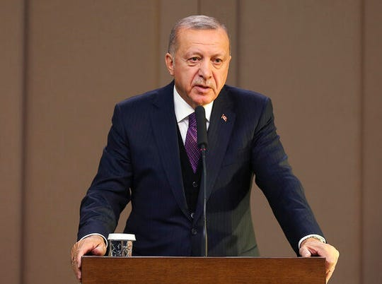 Turkey's President Recep Tayyip Erdogan speaks before departing to attend a NATO leader's summit in London, in Ankara, Turkey, Tuesday, Dec. 3, 2019. Erdogan says there is no change in Turkey's position that is holding up a NATO defense proposal for Poland and Baltic nations until the alliance supports Ankara's concerns related to Syrian Kurdish fighters.