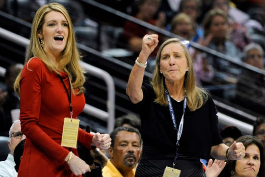 FILE-In this Tuesday, Sept. 6, 2011 file photo, Mary Brock, right, and Kelly Loeffler cheer from their courtside seats as the Atlanta Dream basketball team plays in the second half of their WNBA basketball game, in Atlanta.