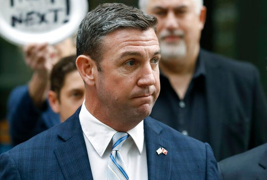 California Republican Rep. Duncan Hunter speaks after leaving federal court Tuesday, Dec. 3, 2019, in San Diego. Hunter gave up his year-long fight against federal corruption charges and pleaded guilty Tuesday to misusing his campaign funds, paving the way for the six-term Republican to step down.