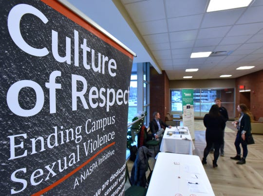 Attendees arrive for the 'Let's End Campus Sexual Assault Summit' at the Eastern Michigan University Student Center on Tuesday morning, December 3, 2019.