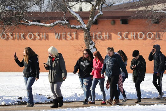 Students are evacuated from the scene of an officer invloved shooting at Oshkosh West High School after an armed student confronted a school resource officer on Tuesday December 3, 2019, at in Oshkosh, Wis. Police in Oshkosh say a police officer and an armed student whom he confronted at the school were both wounded in the confrontation Tuesday morning.