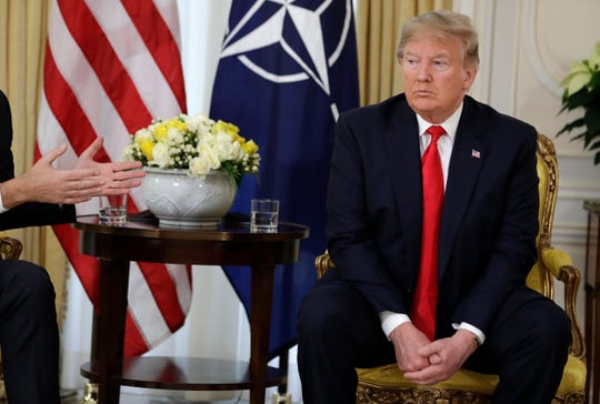 U.S. President Donald Trump meets with NATO Secretary General Jens Stoltenberg at Winfield House in London, Tuesday, Dec. 3, 2019.