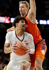 Minnesota Tre' Williams, bottom, battles for position with Clemson forward Hunter Tyson, top, in the first half.