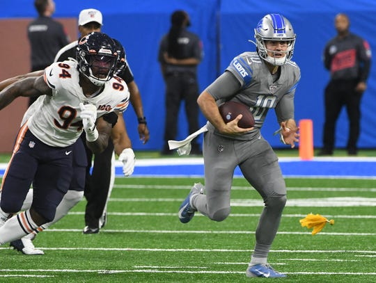 Lions quarterback David Blough breaks out of the pocket for a run as a penalty flag is thrown in last week's game against the Bears. The penalty was called on Detroit.