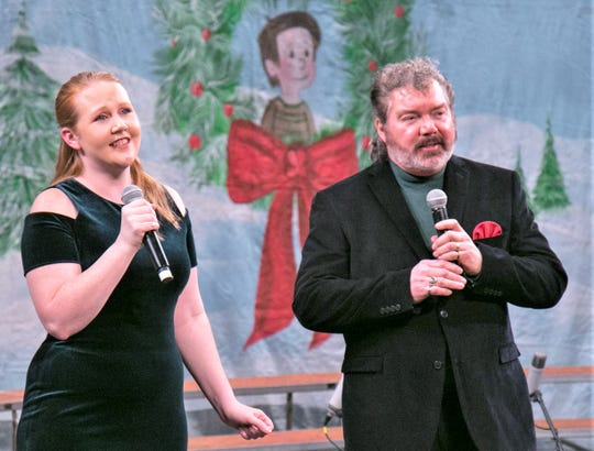 "Amanda Clark sings ""The Christmas Song"" with Michael Burrell near the close of the Arctic League fundraiser broadcast at the Clemens Center on Dec. 1."
