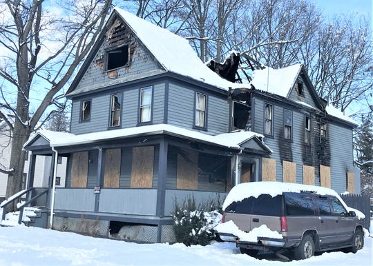 One person was killed when flames broke out Nov. 27 at this house on Elm Street in Elmira.