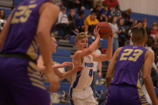 Poudre boys basketball player Nate Wood makes a pass during a game against Fort Collins on Monday, Dec. 2, 2019. Fort Collins won 57-46.