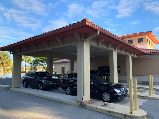 The drive-through lanes for the former bank building that now houses Coconut Point Dental Care are now used as parking spaces.