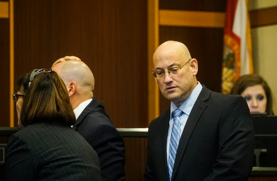 Mark Sievers approaches Judge Bruce Kyle with his attorneys during his trial on Tuesday, Dec, 3, 2019. He charged in the murder of his wife Dr. Teresa Sievers. The defense is bringing forward its witnesses.