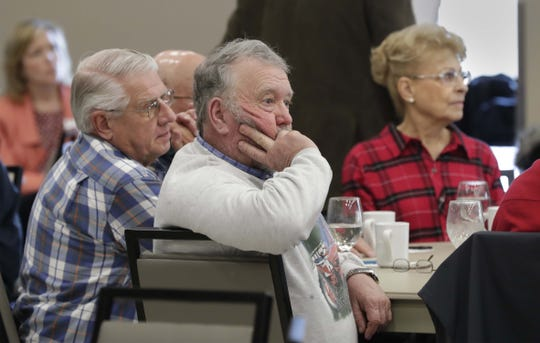 People listen to speakers during the Dairy Town Hall Meeting discussion on the future of dairy farming at the Farm Wisconsin Discovery Center on Tuesday,  in Manitowoc.