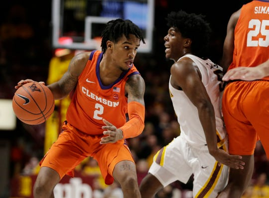 Clemson guard Al-Amir Dawes (2) drives against Minnesota guard Marcus Carr (5) in the second half during an NCAA college basketball game Monday in Minneapolis.