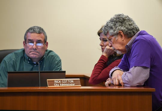Rick Cotton, left, Clemson administrator, and Tanya Hyatt, middle, and Charlie White prepare before a Clemson City Council meeting in Clemson Monday, December 2, 2019.  A presentation by the group Build a Better Clemson was made during the meeting.