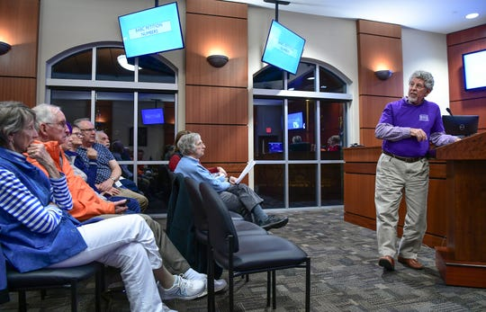 Charlie White talks about statistics from a community poll, during a Clemson City Council meeting in Clemson Monday, December 2, 2019.  A presentation by the group Build a Better Clemson was made during the meeting, sparking a request to pause further approvals for development in the city.